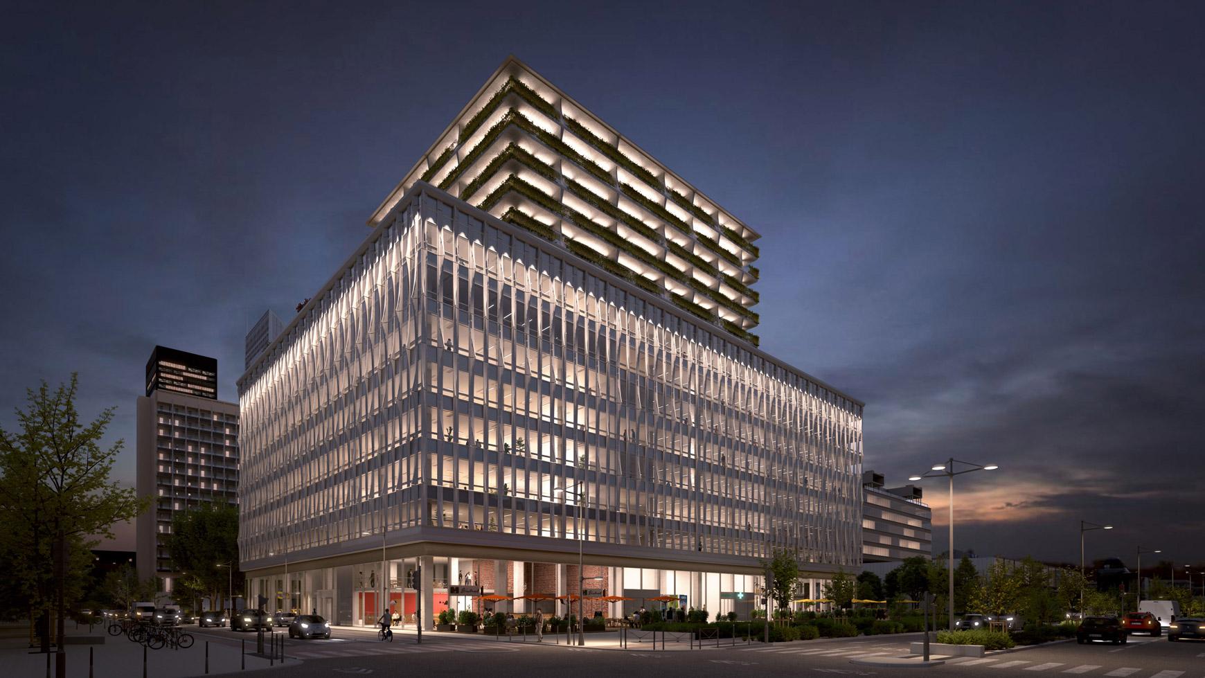 Bâtiment de bureaux, de logements et de commerces à Lyon Part-Dieu, certifié BREEAM EXCELLENT + NF HABITAT HQE + HQE BATIMENT, réalisé par le pôle Tertiaire de l'agence d'architecture SOHO ATLAS IN FINE LYON. Perspective, vue depuis la rue, de nuit.