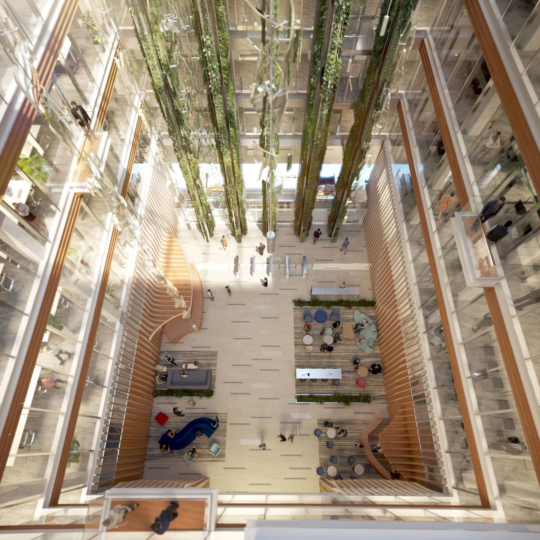 Bâtiment de bureaux, de logements et de commerces à Lyon Part-Dieu, certifié BREEAM EXCELLENT + NF HABITAT HQE + HQE BATIMENT, réalisé par le pôle Tertiaire de l'agence d'architecture SOHO ATLAS IN FINE LYON. Perspective, vue intérieure depuis l'atrium.